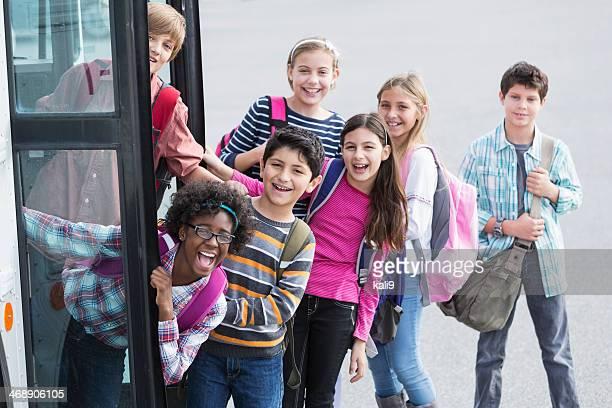 Children getting on school bus
