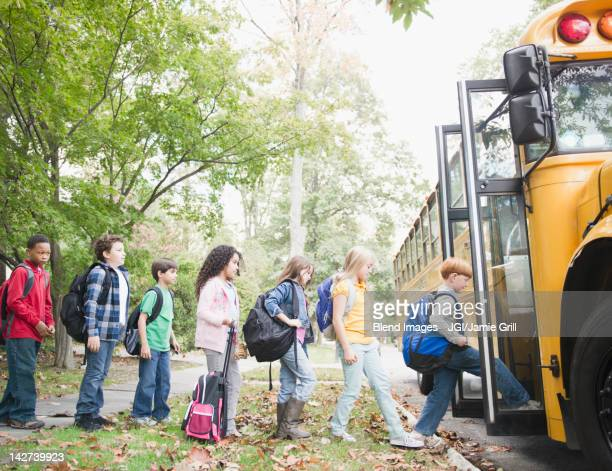 Children getting onto school bus