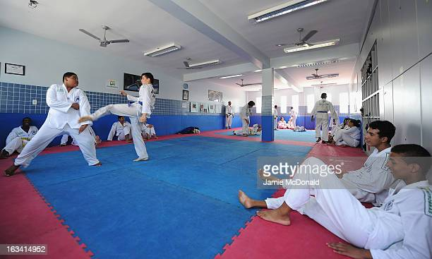 Children give a Tae Kwon Do demonstration during the Luta Pela Paz Project visit at Complexo de Mare during the 2013 Laureus World Sports Awards on...