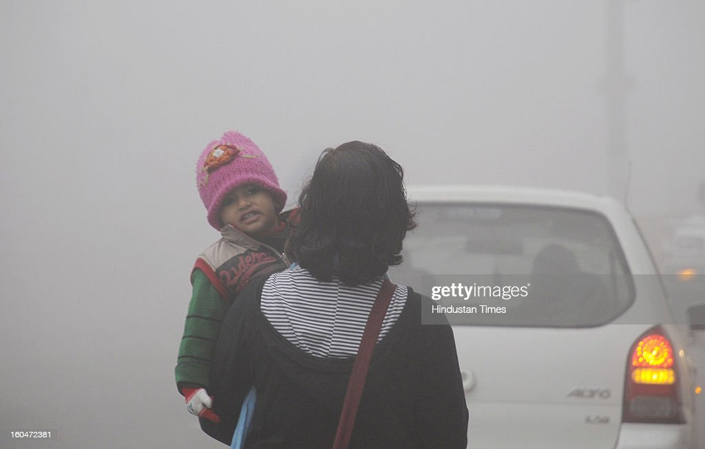 Children going to school in cold foggy morning on February 1, 2013 in Gurgaon, India. Dense fog in Delhi NCR badly affected the daily life of people as visibility, dropped to less than 50 m. This led to the cancellation of 10 trains and delaying over 130 flights, diversions and cancellations of 19 each.