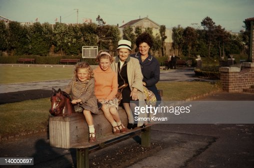 Children, grandmother & mother in playground