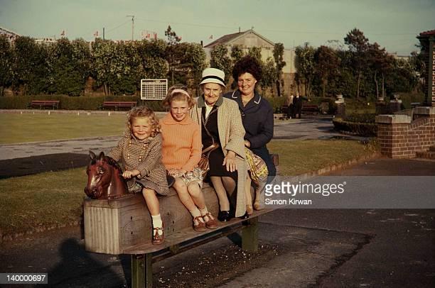Children, grandmother & mother in playground