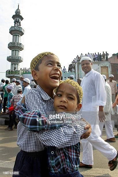 'NEW DELHI INDIA AUGUST 20 Children greet each other after Namaz on EidulFitr at Geeta Colony Mosque on August 20 2012 in New Delhi India Millions of...