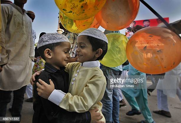 Children greet each other after offering prayers at Jama Masjid on the occasion of Eid alAdha or the Feast of the Sacrifice on October 6 2014 in New...