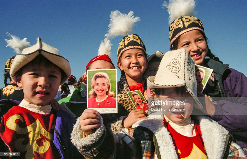 Children greet First Lady Hillary Clinton at Manas International Airport in Bishkek Kyrgyzstan on November 12 1997 Clinton was touring Central Asian...