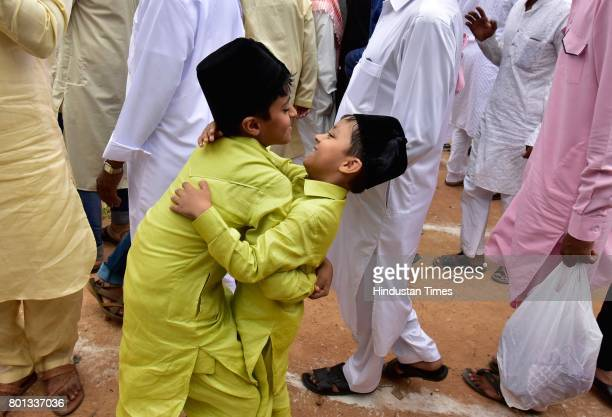 Children greeting each other after prayers on the occasion of EidUlFitr at Quddus Saheb Eidgah on June 26 2017 in Bengaluru India The celebrations...