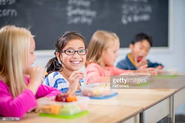 Children Happily Eating Healthy Snacks