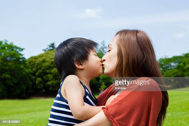 Children have a mother and a kiss