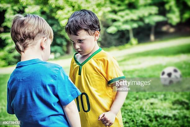 Children Having a Raw During a Soccer Match