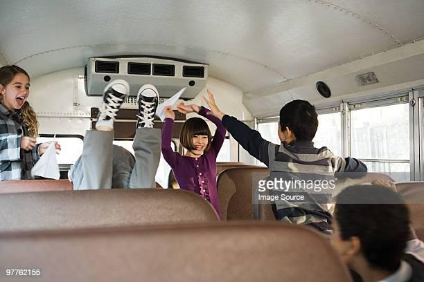 Children having fun on school bus