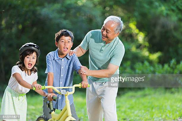 Children having fun with grandfather