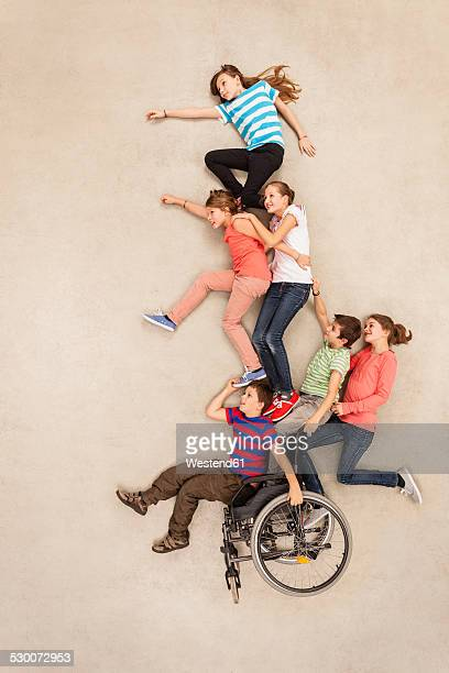 Children having fun with handicapped friend
