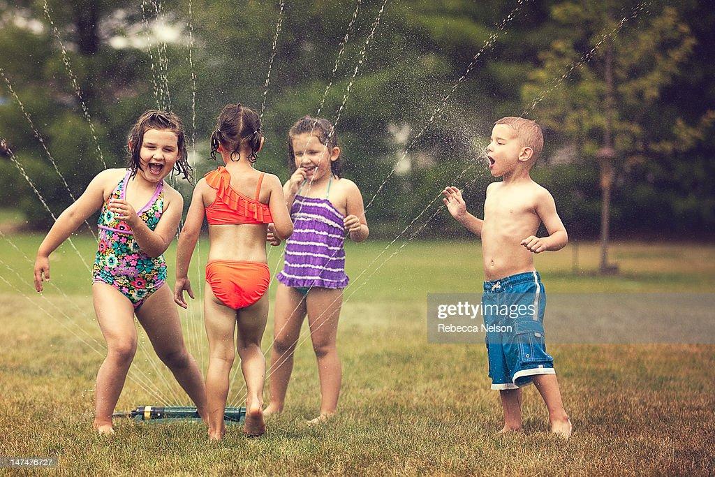 Children Having Summer Fun with Water : Stock Photo