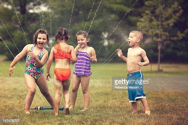 Children Having Summer Fun with Water
