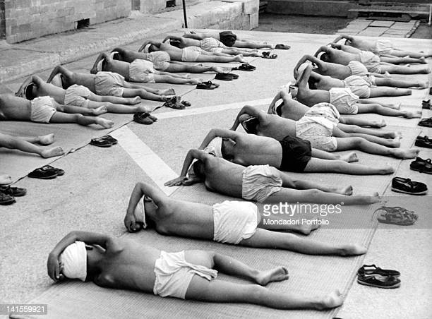 Children having sun therapy in a Beijing kindergarten Beijing 1961