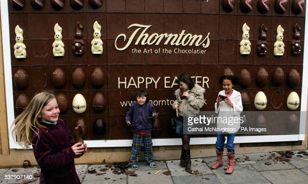 Children help themselves to the worlds first edible chocolate billboard at Covent Garden central London