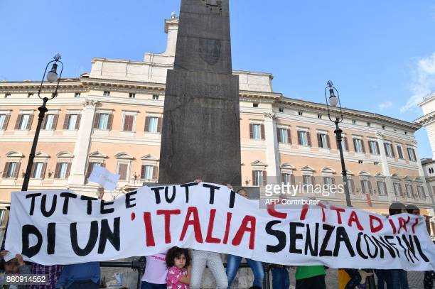 Children hold a banner reading 'All citizens of an Italy without borders' on October 13 2017 in front of the Italian Parliament in Rome during a...
