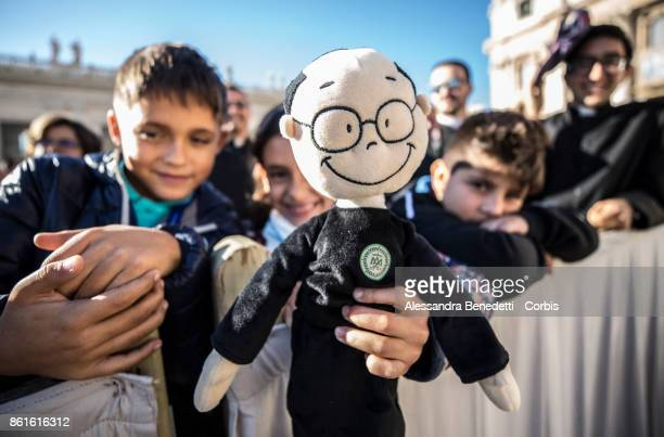 Children hold a puppet depicting St Faustino Minguez during a canonisation ceremony held by Pope Francis on October 15 2017 in Vatican City Vatican...