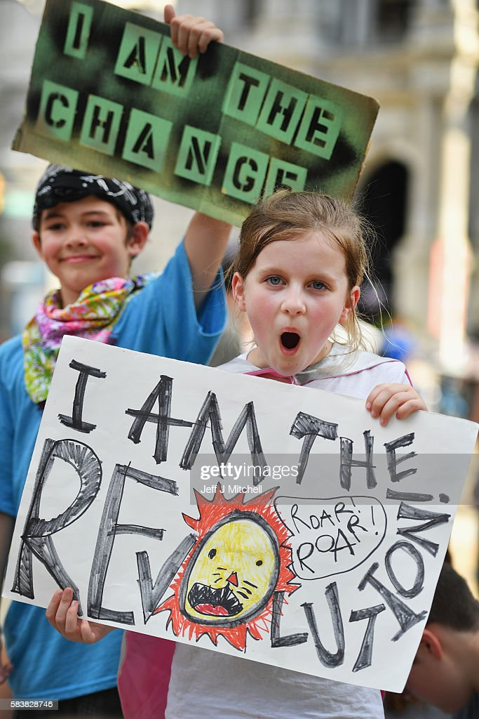Children hold banners at a Bernie Sanders event near City Hall on day three of the Democratic National Convention (DNC) on July 27, 2016 in Philadelphia, Pennsylvania. The convention officially began on Monday and has attracted thousands of protesters, members of the media and Democratic delegates to the City of Brotherly Love.