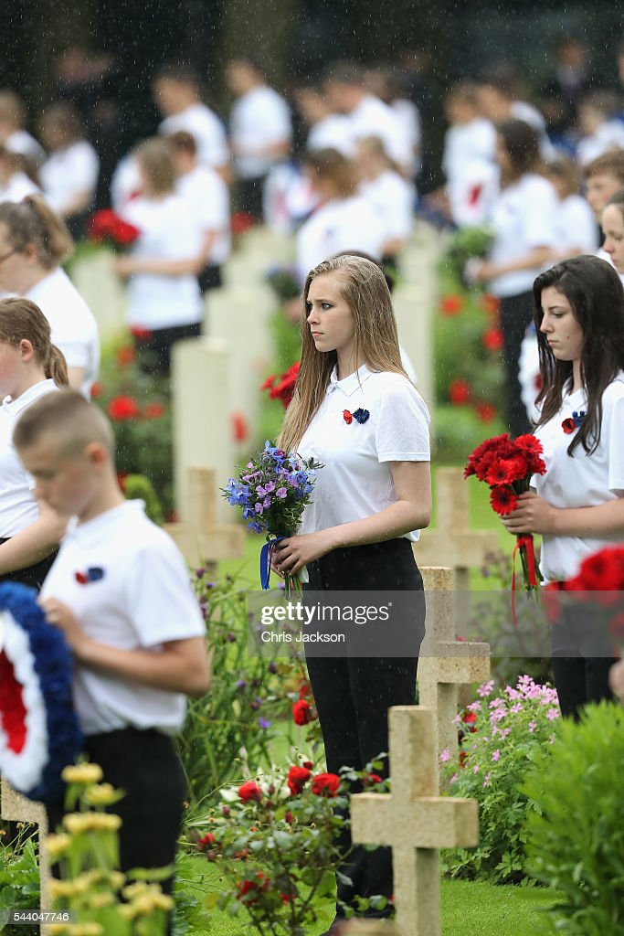 Children hold flowers as they take part in Somme Centenary Commemorations on July 1, 2016 in Thiepval, France. Today marks exactly 100 years since the beginning of the battle of the Somme.
