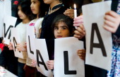 Children hold up letters spelling out the name 'Malala' at St Paul's Church and St Silas in Lozells Birmingham England on November 10 2012 In part of...