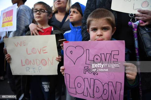 Children hold up messages for the victims of the London terrorist attacks at the County Hotel on June 4 2017 in Carlisle England Campaigning for the...