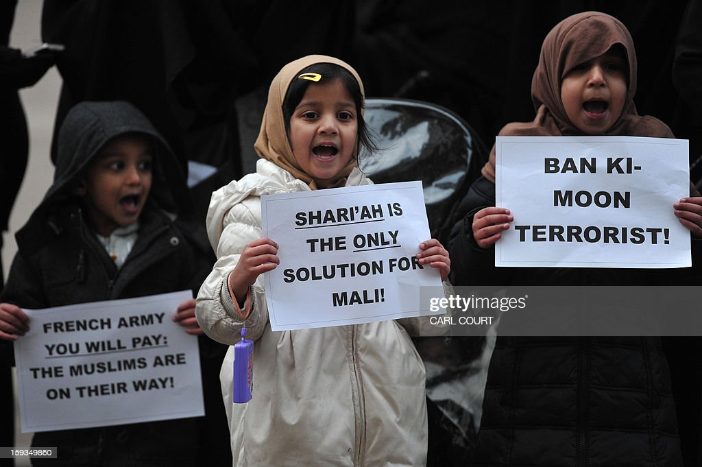 Children hold up signs as they join a protest in response to French military action in Mali outside the French embassy in central London on January 12, 2013. Around 50 Muslim protesters shouted slogans and waved signs as they demonstrated outside the French embassy against French intervention in Mali. France sent troops on January 11 to help Malian forces hold back a rebel advance towards the capital Bamako, and on January 12 Paris announced that a French military pilot had been killed.