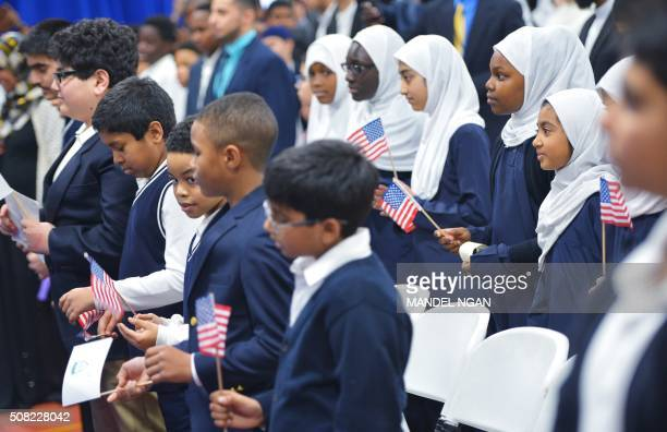 Children hold US flags as US President Barack Obama speaks in an overflow room during a visit to the Islamic Society of Baltimore in Windsor Mill...