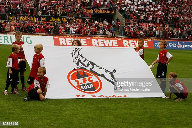 Children holding a flag of Koeln on the pitch prior the Bundesliga match between 1 FC Koeln and Bayern Muenchen at the RheinEnergie stadium on...