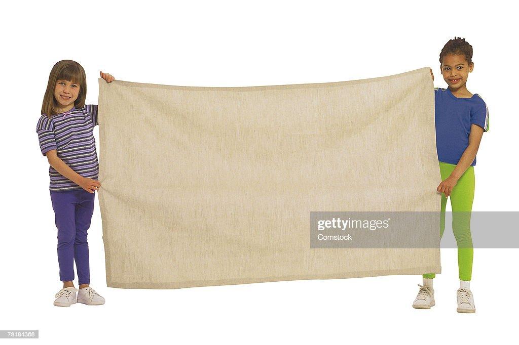 Children holding canvas banner