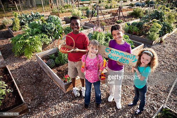 Children holding community garden sign