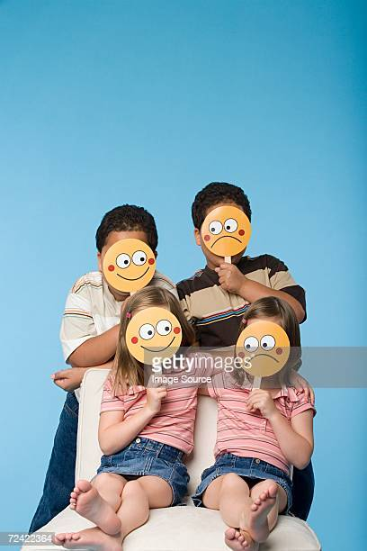 Children holding face masks