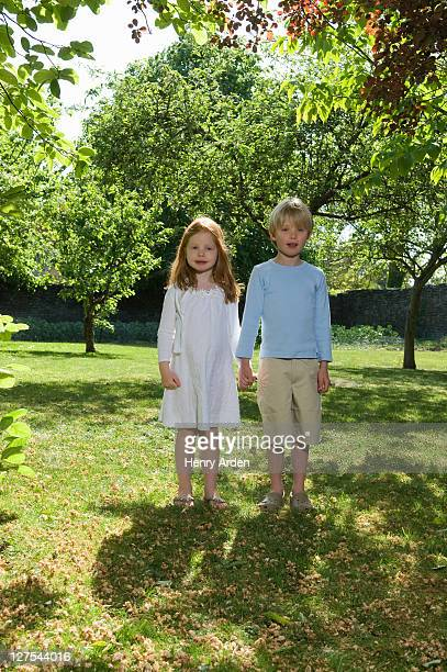 Children holding hands in backyard