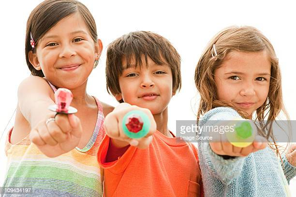 Children holding lollipops