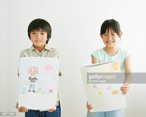 Children Holding Painting