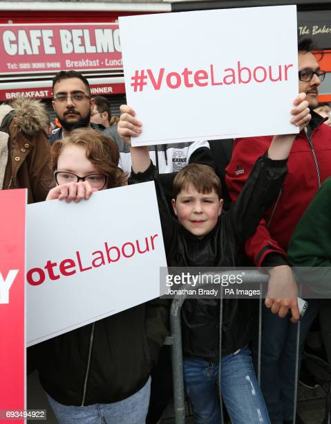 Children holding placards as a crowd gathers ahead of an appearance by Labour leader Jeremy Corbyn at a General Election campaign event in Harrow
