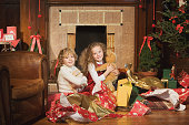 Children holding their Christmas gifts