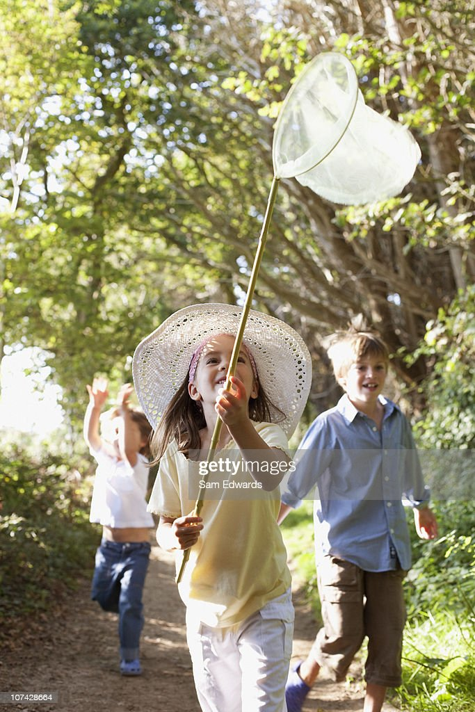 Children hunting with butterfly net : Stock Photo
