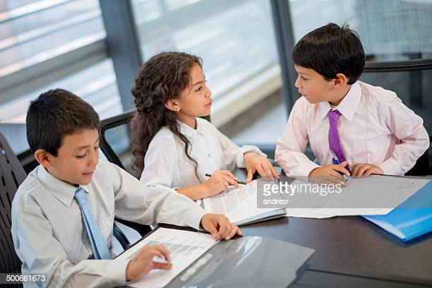 Children in a business meeting