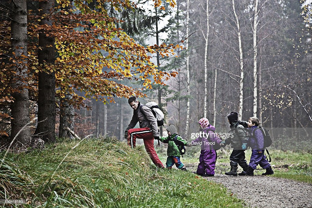 Children in a forest kindergarten in Denmark. : Stock Photo