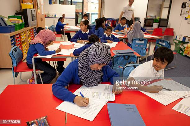 Children in a Year 6 class at Marner Primary School in Tower Hamlets concentrate on their writing during a lesson This is one of the schools close to...