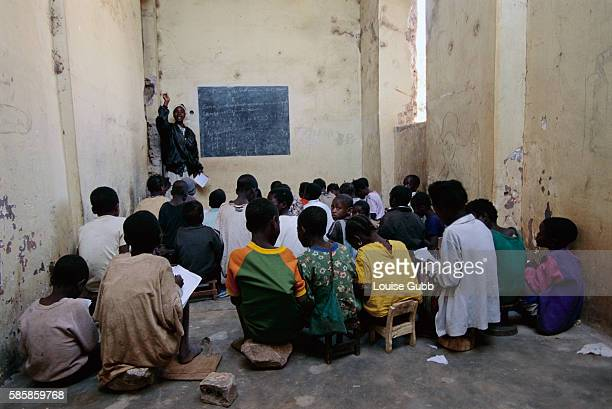 Children in Camacup Angola attend school in a roofless wardamaged building After Angola gained independence from Portugal in 1975 civil war erupted...