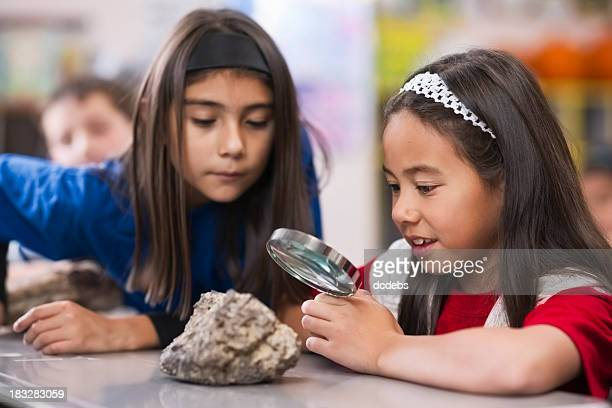 Children in Classroom With Magnifying Glass