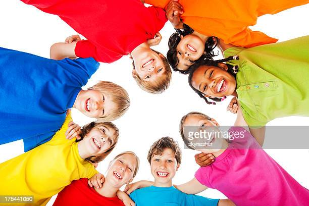 Children in colorful t-shirts isolated on white.