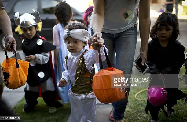 Children in costume during Halloween ready for the traditional trickortreating practice in Santiago on October 31 2014 More and more Chilean people...