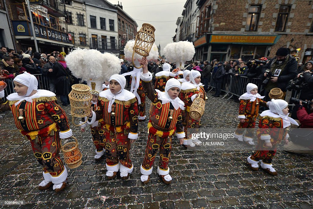 Children in costume take part in the carnaval of Binche on February 9, 2016. The Binche Carnival tradition is one of the most ancient and representative of Wallonia and its inscribed since 2008 as on the Representative List of the Intangible Cultural Heritage of Humanity by UNESCO. / AFP / BELGA AND Belga / ERIC LALMAND / Belgium OUT