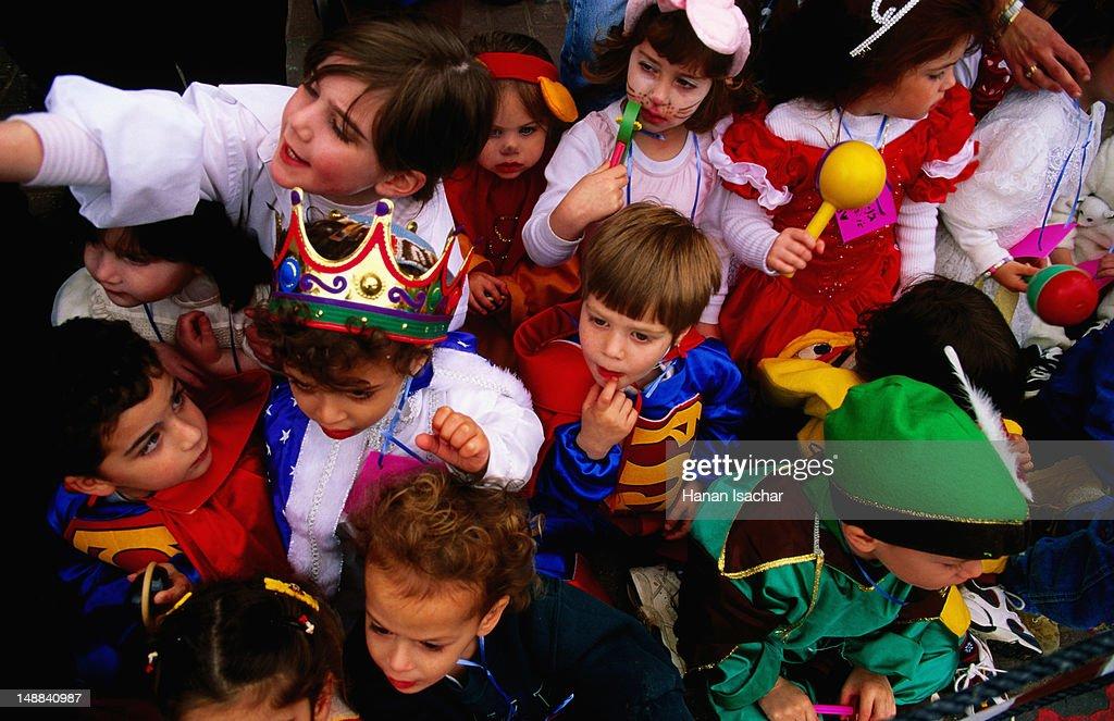 Children in costumes celebrating Purim.