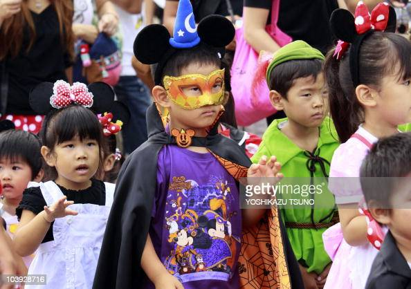 Children in costumes of Disney characters march during a parade for Halloween at the Tokyo Disneyland at Urayasu city in Chiba prefecture suburban...