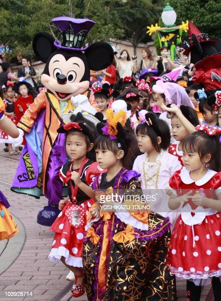 Children in costumes of Disney characters march with Mickey Mouse during a parade for Halloween at the Tokyo Disneyland at Urayasu city in Chiba...