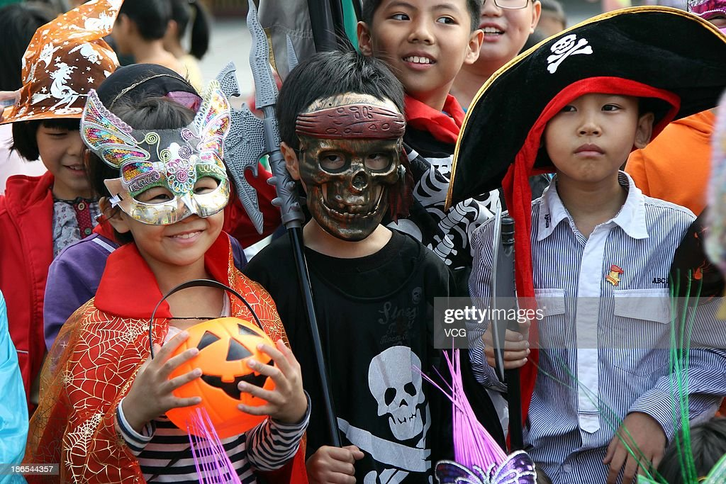 Children in fancy dress costumes celebrate Halloween at a primary school on October 31 2013 in Jinjiang China